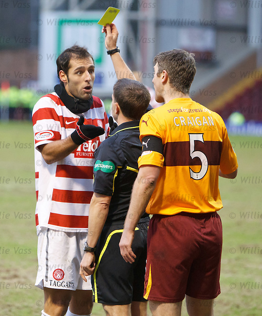 Hamilton's Portuguese midfielder Flavio Paixao is booked for a challenge on Stephen Craigan