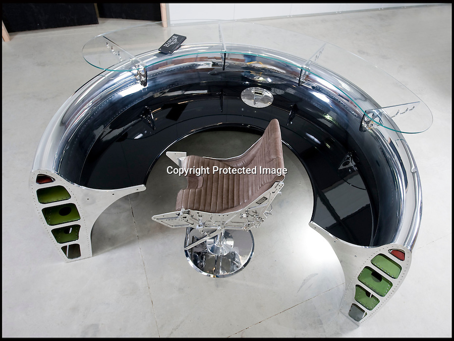 BNPS.co.uk (01202 558833)<br /> Pic: PhilYeomans/BNPS<br /> <br /> Bespoke furniture for the Jet Set.<br /> <br /> A &pound;20,000 reception desk made from a 737 engine intake. The &pound;7000 chair comes from a Martin Baker ejection seat.<br /> <br /> Two brother's have come up with ultimate in aircraft recycling - turning unwanted bits of redundant airliners into highly desirable - and highly expensive - bespoke items of furniture.<br /> <br /> Brett and Shane Armstrong from Kent scour the worlds aircraft graveyards looking for interesting items they can rescue from sad decay and with a lot of imagination and elbow grease convert into one-off gleaming items of furniture costing thousands of pounds.