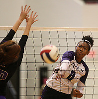 Arkansas Democrat-Gazette/STATON BREIDENTHAL --10/29/19-- Fayetteville's Rosana Hicks (right) hits the ball past Mount St. Mary defender Catalina Williams Tuesday during their game in the 6A state Volleyball Tournament in Cabot. See more photos at arkansasonline.com/1030volleyball6A/.