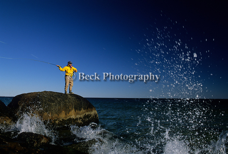 Peter Jenkins casts to a striper off the Rhode Island coast