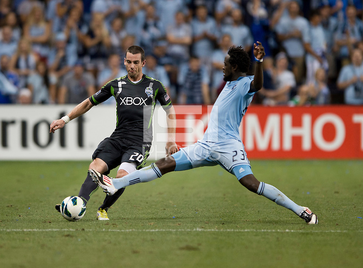 Zach Scott, Kei Kamara. Sporting Kansas City won the Lamar Hunt U.S. Open Cup on penalty kicks after tying the Seattle Sounders in overtime at Livestrong Sporting Park in Kansas City, Kansas.