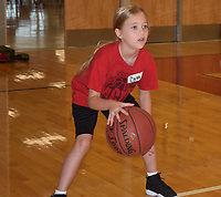 RICK PECK/SPECIAL TO MCDONALD COUNTY PRESS<br /> Nine-year-old Cami Washam of Anderson works on her dribbling skills during a youth basketball/volleyball camp held July 8-10 at McDonald County High School.