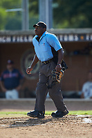 Home plate umpire Marcus Neal tracks a fly ball down the left field line during the game between the Statesville Owls and the High Point-Thomasville HiToms at Finch Field on July 19, 2020 in Thomasville, NC. The HiToms defeated the Owls 21-0. (Brian Westerholt/Four Seam Images)
