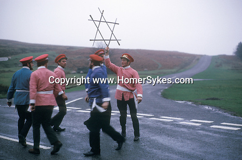 Goathland Plough Stots. Goathland Yorkshire UK  The Longsword  Dance Team 1972. The King holds the Lock above their heads at the end of a dance.