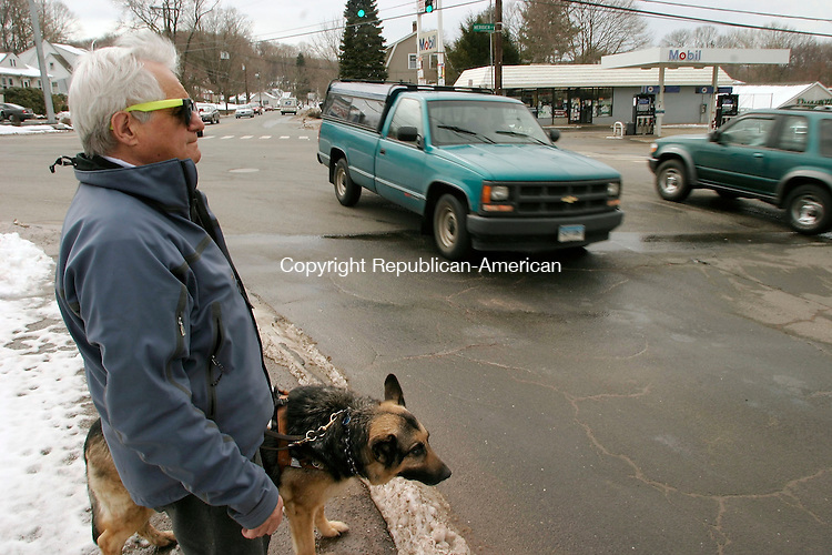 WATERBURY, CT- 25 MARCH 2005-032505J03--Waterbury resident John Casolo and his guide dog Gregger, wait to cross the street at the corner of Meriden and Frost Road in Waterbury. Casolo, 72, is blind and has trouble crossing at the intersection and is asking of audible traffic signals at major intersections.--- Jim Shannon Photo-- John Casolo; Waterbury; Gregger, Meriden,  Frost Road are CQ