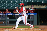 Brad Debo (12) of the North Carolina State Wolfpack follows through on his swing against the Boston College Eagles in Game Two of the 2017 ACC Baseball Championship at Louisville Slugger Field on May 23, 2017 in Louisville, Kentucky. The Wolfpack defeated the Eagles 6-1. (Brian Westerholt/Four Seam Images)