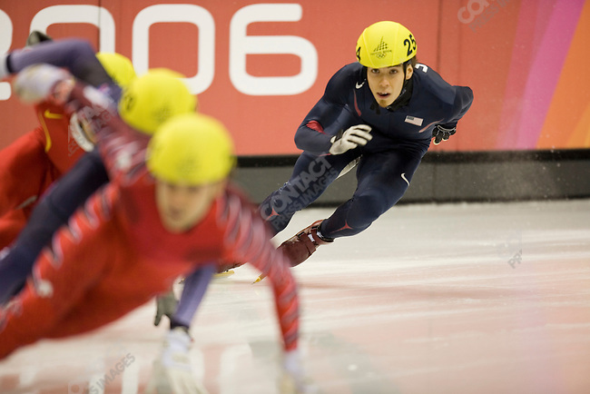 Short track speed skating at the Palavela during the Torino Winter Olympics. Apolo Anton Ohno of USA finds himself in last place during the semi-final of the men's 500m short track race. Ohno found a way to advance to the finals and would win the gold medal in the event.