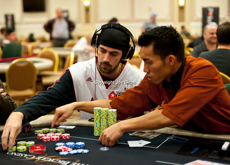 Team Pokerstars Pro Jason Mercier gets help counting his chips from the dealer after a double up.