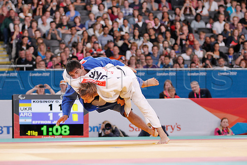 31.08.2012. London, England, 2012 Paralympic Games.   judo final action. u81 kilo Olexandr Kosinov (UKR) white, throws Jose Effron (ARG)in the u81kilo final to win the gold medal in golden score.