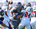 SIOUX FALLS, SD - SEPTEMBER 6: Jarrett Grabbe #97  from the University of Sioux Falls eyes the quarterback while trying to shed a block from Minot State in the first quarter of their game Saturday afternoon at Bob Young Field in Sioux Falls.  (Photo by Dave Eggen/Inertia)