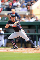 Atlanta Braves outfielder Jordan Schafer (17) fouls off a bunt during a spring training game against the Detroit Tigers on February 27, 2014 at Joker Marchant Stadium in Lakeland, Florida.  Detroit defeated Atlanta 5-2.  (Mike Janes/Four Seam Images)