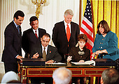Deputy Prime Minister for Economic Affairs Dr. Mohammad Halaika of Jordan and United States Trade Representative Ambassador Charlene Barshefsky sign the Free Trade Agreement between the United States and the Hashemite Kingdom of Jordan in the East Room of the White House in Washington, D.C. on October 24, 2000. King Abdullah II of Jordan and U.S. President Bill Clinton look on..Credit: Ron Sachs / CNP