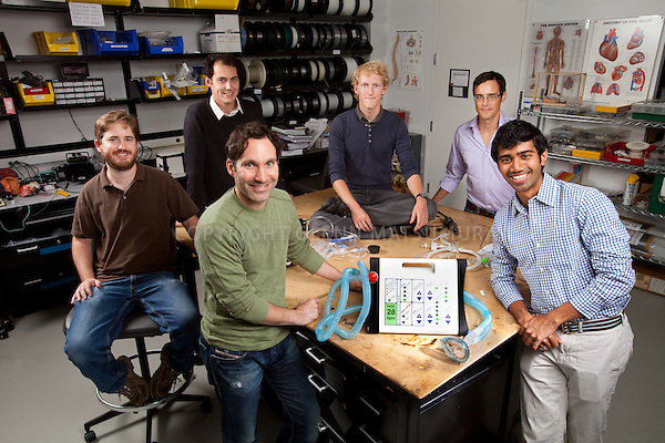 Matthew Callaghan and rest of the Stanford biodesign team created a low cost ventilator. Photographed in the biodesign lab in the Clark Center. Clockwise from front: Matthew Callaghan (green shirt), Larry Miller, François Brahic, Will Bishop, Frederick Winston, Dhruv Goddupalli