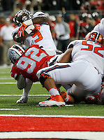 Ohio State Buckeyes defensive lineman Adolphus Washington (92) takes down Illinois Fighting Illini running back Donovonn Young (5) as he runs the ball in the second quarter the college football game between the Ohio State Buckeyes and the Illinois Fighting Illini at Ohio Stadium in Columbus, Saturday night, November 1, 2014. The Ohio State Buckeyes defeated the Illinois Fighting Illini 55 - 14. (The Columbus Dispatch / Eamon Queeney)