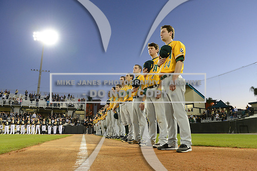Siena Saints coach Elliot Glynn (44), infielder Brett Connors (2), pitcher Justin Scala (5), infielder Yahriel Jimenez (7), outfielder Mike Williams (9) during the national anthem before the season opening game against the Central Florida Knights at Jay Bergman Field on February 14, 2014 in Orlando, Florida.  UCF defeated Siena 8-1.  (Copyright Mike Janes Photography)