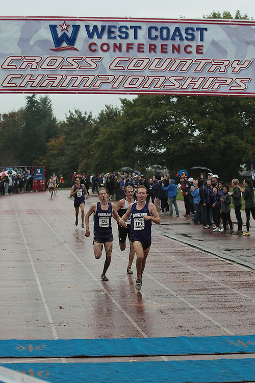 October 27, 2012; Portland, OR, USA; Portland Pilots runner Scott Fauble (119) Portland Pilots runner William Kincaid (123) BYU Cougars runner Tylor Thatcher (23) during the WCC Cross Country Championships at Fernhill Park.