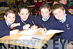 TOGETHER: heads together to answer the questions at the Clanmaurice Credit Union primary School, table quiz at Causeway Comprehensive Sec School, on Sunday were pupils from Killury NS Causeway, Killian Yallop,Dean Fitzpatrick, Sean Sheahan  and Karol Jureck.. .