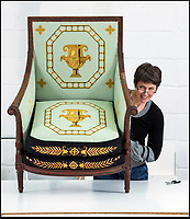BNPS.co.uk (01202 558833)<br /> Pic: PhilYeomans/BNPS<br /> <br /> Conservator Emma Telford with a restored chair.<br /> <br /> Seat of Power - The First Duke of Marlborough&rsquo;s campaign chairs, upon which he sat to plot the downfall of the French King Louis XIV, are returning to Blenheim Palace following an 18-month restoration.<br />