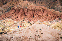 Two people hiking in Fairy Tale Canyon, or Skazka, in Kyrgyzstan