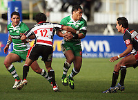 Manawatu centre Johnny Leota tries to run between Tasesa Lavea and Josh Hall, with Frankie Bryant (left) in support during the Air NZ Cup rugby match between Manawatu Turbos and Counties-Manukau Steelers at FMG Stadium, Palmerston North, New Zealand on Sunday, 2 August 2009. Photo: Dave Lintott / lintottphoto.co.nz