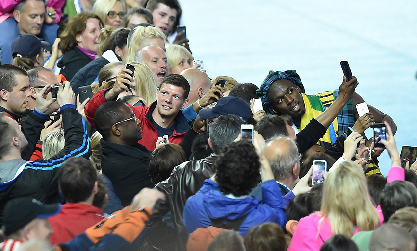 Jamaica's Usain Bolt celebrates with the crowd at Hampden Park after completing the win for his nation in the 4x100m final<br /> <br /> Photographer Chris Vaughan/CameraSport<br /> <br /> 20th Commonwealth Games - Day 10 - Saturday 2nd August 2014 - Athletics - Hampden Park - Glasgow - UK<br /> <br /> © CameraSport - 43 Linden Ave. Countesthorpe. Leicester. England. LE8 5PG - Tel: +44 (0) 116 277 4147 - admin@CameraSport.com - www.CameraSport.com