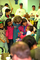 Founder Mary Jo & kids at Sharing & Caring Hands soup kitchen.  Minneapolis Minnesota USA