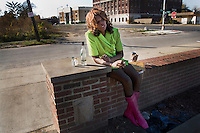 """Deborah"", who works as a prostitute, getting drunk in front of a liquor store in Detroit, Michigan."