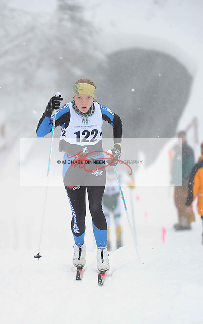 Chugiak's Cllaire Mahoney skis through a snowstorm to her 11th place finish at the Chugiak Stampede Saturday, January 14, 2017.  Photo for the Star by Michael Dinneen