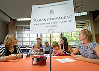 NWA Democrat-Gazette/BEN GOFF &bull; @NWABENGOFF<br /> Renee Van Hersh (from left) Tobi Harrell and son Foster Harrell, 1, Laurie Monday and daughter Emily Monday, 2, and Katrin Clubine chat on Monday Aug. 3, 2015 at the 'Cheers and Tears' kindergarten parent social during the first day of school at R.E. Baker Elementary in Bentonville. Harrell and Clubine, parents of older children at the school, were on hand at the parent-to-parent table at the informational breakfast and social to help answer questions for kindergarden parents.