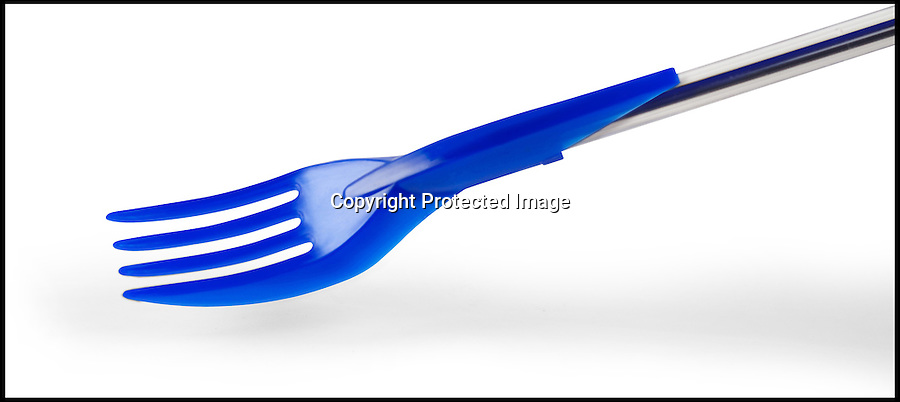 BNPS.co.uk (01202) 558833<br /> Picture: ZoLoft/BNPS<br /> <br /> ****Please use full byline****<br /> <br /> Working lunch...<br /> <br /> A range of cutlery that doubles up as pen toppers has been invented so workaholics can eat their lunch without having to leave their desk.<br /> <br /> The £5.49 lid has been designed to slot on to a standard Biro to make it easier for office staff to stop and grab a bite to eat while in the middle of a piece of work.<br /> <br /> The quirky caps are shaped like a knife, fork, and spoon and are interchangeable depending on what a user would like to eat.