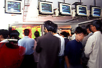 Speculators check share prices at China Securities Co, in Shenzhen, China. Stock speculation is rampant in China.