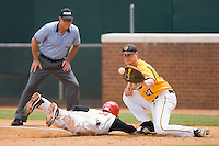 Sean O'Hare #3 of the St. John's Red Storm dives back to first base as Brent Mikionis #27 of the VCU Rams waits for the throw at the Charlottesville Regional of the 2010 College World Series at Davenport Field on June 5, 2010, in Charlottesville, Virginia.  The Red Storm defeated the Rams 8-6.  Photo by Brian Westerholt / Four Seam Images