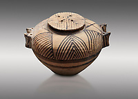 Cycladic ceramic spherical pyxis with painted linear decoration. Cycladic II (2800-2300 BC) , Chalandriani, Syros. National Archaeological Museum Athens. Cat no 5170.   Grey background.