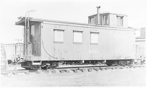 3/4 view of long caboose #0586.<br /> D&amp;RGW