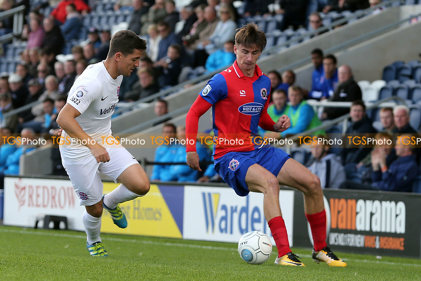 Andrew Bond of AFC Fylde   and Oliver Hawkins of Dagenham during AFC Fylde vs Dagenham & Redbridge, Vanarama National League Football at Mill Farm on 19th August 2017