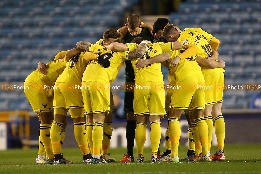 Oxford players huddle ahead of the kick-off during Millwall vs Oxford United at The Den