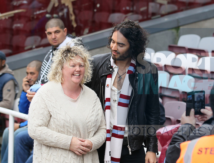 West Ham fan Russell Brand chats with fans<br /> <br /> Barclays Premier League - West Ham United vs Manchester City - Upton Park - England - 25th October 2014 - Picture David Klein/Sportimage