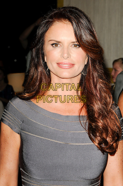 ROMA DOWNEY.arriving at Operation Smile at the Beverly Hilton Hotel in Beverly Hills, California, USA, October 2nd 2009..portrait headshot grey gray .CAP/ROT.©Lee Roth/Capital Pictures.