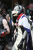 "29 June 2013, London, United Kingdom. Picture: Men in latex suits and dog masks. Pride London 2013 parade starts with the motto ""love (and marriage)""."
