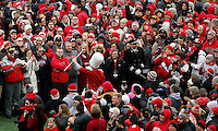 The crowd on the field surrounds the Ohio State marching band drum major during the Ohio State football National Championship celebration at Ohio Stadium on Saturday, January 24, 2015. (Columbus Dispatch photo by Jonathan Quilter)