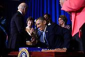 United States President Barack Obama signs the Violence against Women Act in Washington, D.C. on Thursday, March  7, 2013..Credit: Dennis Brack / Pool via CNP