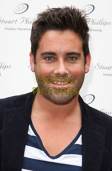 GILES VICKERS JONES .Stuart Phillips Salon 15th Anniversary Party at Covent Garden, London, England, UK, July 15th 2009.portrait headshot v-neck blue and white striped black stubble facial hair .CAP/ROS.©Steve Ross/Capital Pictures