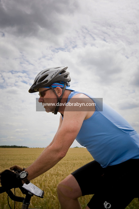 Writer David Darlington, participant in a Backroads cycle tour of the Loire Valley, rides near Amboise, France, 26 June 2008.
