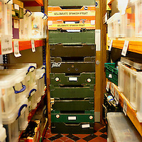 Boxes stored inside the store room of Hammersmith and Fulham food bank in Christ Church, Fulham. Volunteers meet customers, offering a hot drink and cake before an interview is carried out to assess the person's needs. After this specially-selected bags of food are made up. Many food banks are run in or by local churches though not all volunteers at this bank would describe themselves as regular church goers.