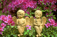 Two angels watch the garden surrounded by Azaleas