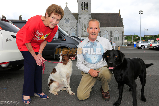 Margaret and Gerry Dagg with Toby and Jamie at the dog walk<br /> Picture:  Fran Caffrey www.newsfile.ie