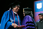 Cheryl Procter-Rogers, student in the School for New Learning and former vice president of DePaul's Office of Public Relations and Communications, receives her degree from Marisa Alicea, dean of the School for New Learning, Saturday, June 10, 2017, during the DePaul University School for New Learning commencement ceremony at the Rosemont Theatre in Rosemont, IL. (DePaul University/Jeff Carrion)
