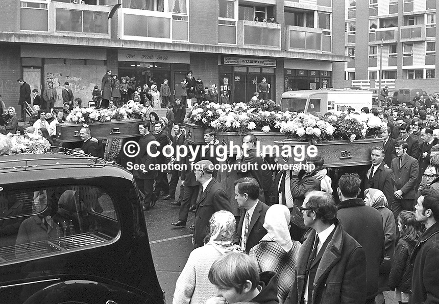 The funeral of victims of the McGurk's Bar explosion. Fifteen died in the blast, including the bar owner's wife and daughter, and 13 were injured. Pic includes a youthful Gerry Fitt. One of the injured subsequently died. NI Troubles. Ref: 19711207001<br />