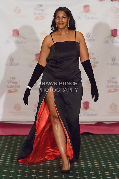 Model walks runway in an outfit from the Ms. Chalane collection by Victoria Clark Davis on September 24, 2017 at the Trenton Country Club.