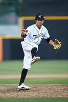 Fayetteville Woodpeckers relief pitcher Willy Collado (15) follows through on his delivery against the Carolina Mudcats at SEGRA Stadium on May 18, 2019 in Fayetteville, North Carolina. The Mudcats defeated the Woodpeckers 6-4. (Brian Westerholt/Four Seam Images)